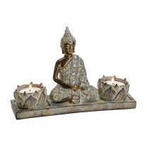 Thailandsk Buddha med to lys