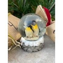 Glaskugle med pingviner