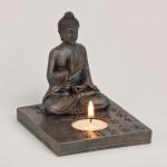 Buddha figur med fyrfadlys